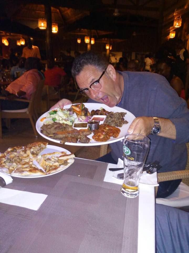 Paul Kavanagh having dinner in a bar in Accra Ghana