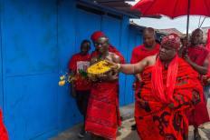 Ga People Accra men in red