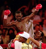 WBC super featherweight champion Azumah Nelson of Ghana, Africa, top, celebrates his victory over James Leija of San Antonio, Tx., Saturday night, June 1, 1996, at Boulder Station in Las Vegas. Nelson defeated Leija by technical knockout in the sixth round. (AP Photo/Lennox McLendon)